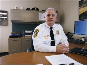 CTY sylchief17p Sylvania Police Captain Rhodus, who will become Sylvania's new police chief on April 26,  in the police department in Sylvania, Ohio on March 16, 2010. Jetta Fraser/Toledo Blade