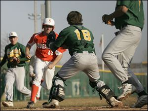 David Vandercook, above, charges toward home plate in a game against Clay. Brother Todd, below, scores for Sylvania in the same game.