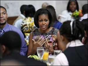 First lady Michelle Obama talks with students at a White House youth leadership and mentoring luncheon at the Detroit Institute of Arts in Detroit, Wednesday.