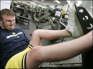 Brock Mealer, 25, works on his rehabilitation at the University of Michigan's football weight training facility inside Schembechler Hall in Ann Arbor.
