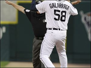 Tigers pitcher Armando Galarraga takes the throw at first base for what would have been the final out of the first perfect game by a Detroit pitcher. TV replays show Cleveland's Jason Donald was out but he was called safe.