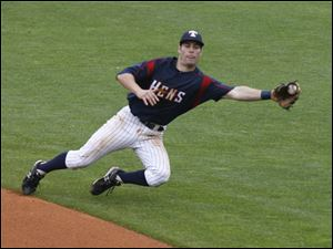 Toledo second baseman Scott Sizemore snags a ground ball, but Chris Duffy beat Sizemore's throw to first base.