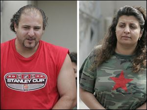 Hor Akl and his wife, Amera, appeared in federal court in Toledo Thursday.