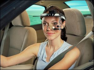 A head-mounted sensor array monitors eye movement and fatigue during an experiement at Ford.