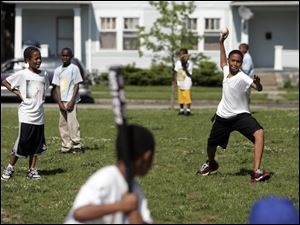 Juan Johnson, 13, pitches during a game at the Toledo Boys and Girls Clubs program at Sherman Elementary School.