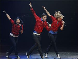 "Jenna Ushkowitz, left, Chris Colfer, middle, and Heather Morris, members of the cast of the popular television show "" Glee"" perform during a concert to kickoff a national "" Glee"" tour May 15 at the Dodge Theatre in Phoenix."
