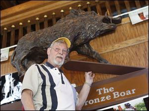 John Orr, owner of the Bronze Boar on South Huron Street downtown, is missing his 150-pound statue. The police say they have no leads but believe that pranksters were responsible.