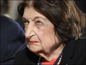 FILE - In this May 27, 2010 file photo, Helen Thomas listens to President Barack Obama during a news conference in the East Room of the White House in Washington. Controversial remarks about Israel by veteran White House reporter Helen Thomas drew sharp criticism from the Obama administration on Monday, as well as the cancellation of a high school graduation speech she was to deliver. White House press secretary Robert Gibbs was asked at his daily briefing with reporters about President Barack Obama's reaction to Thomas' remarks. Gibbs called them