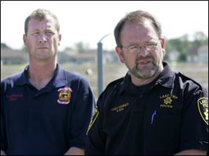 Lake Township Fire Chief Todd Walters, left, and