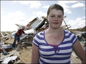 Sierra Richardson, 13, of Liberty Center was inside a house on County Road 7 when the tornado struck. No one heard a siren.