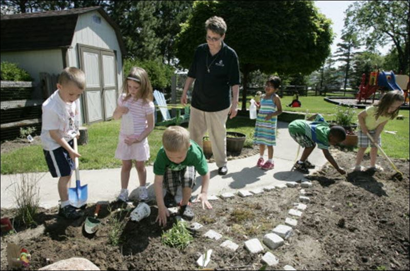 Weed it reap maria learning center toledo blade for Maria s garden center
