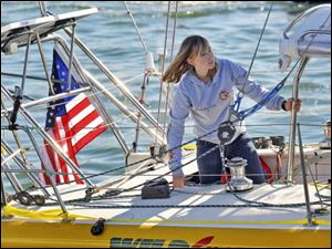 Abby Sunderland, 16, looks out from her sailboat, Wild Eyes, as she leaves for her world record attempting journey at the Del Rey Yacht Club in Marina del Rey, Calif., in this Jan. 23 file photo.