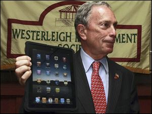 New York Mayor Michael Bloomberg, showing off his iPad, says he isn't troubled that his e-mail address was one of those exposed.