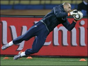 U.S. team goalkeeper Tim Howard gets a workout yesterday at the Royal Bafokeng Stadium in Rustenburg, South Africa.