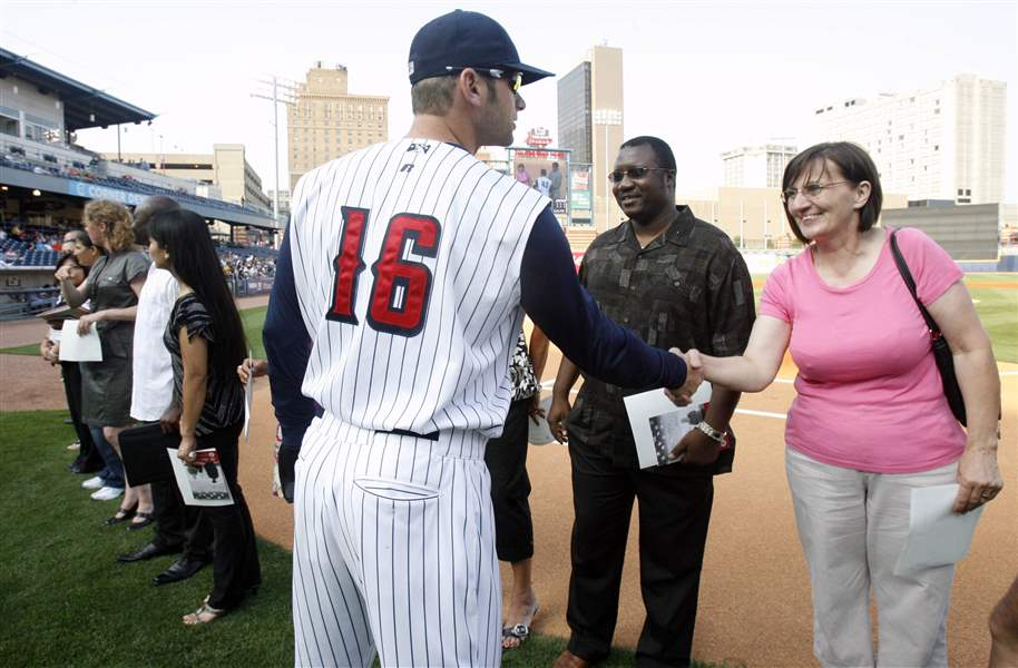 New-citizens-introduced-at-baseball-game-2