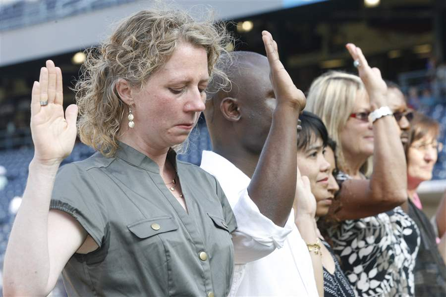 New-citizens-introduced-at-baseball-game-3