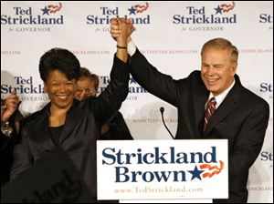 Yvette McGee Brown, left, is introduced earlier this year by Gov. Ted Strickland as his running mate for his re-election.
