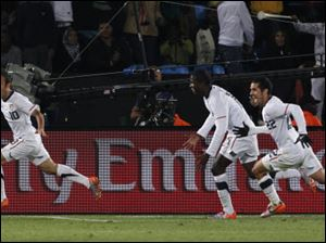 Landon Donovan, left, celebrates after scoring the go-ahead goal with fellow team members Benny Feilhaber, right, and Edson Buddle, second from right, during the World Cup group C match against Algeria.