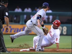 The Indians' Jason Donald tags out Shane Victorino on a steal attempt.