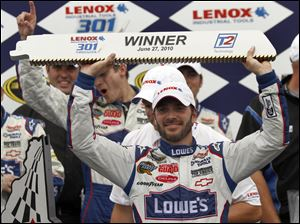 Jimmie Johnson celebrates in Victory Lane after winning the Lenox Industrial Tools 301.