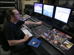 Christopher Stoll is among dozens of musicians and singers who came together at the Zeta Recording Studio in Holland to re-record a musical tribute to America's military veterans.