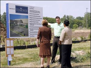 Gregory Adanin, Ventower president and chief executive, provides a progress report at the start-up's construction site to Michigan state officials Terri Novak, left, and Velma Johnson. Viciana