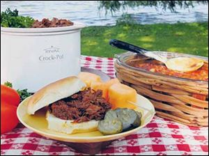 Barbecued Beef and Three-Bean Baked Beans on the picnic table.