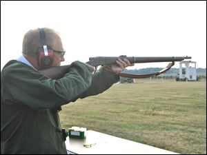 Gov. Ted Strickland fires the ceremonial first shot of Matches at Camp Perry on Monday using a historic 1878 single shot Sharps .45/70 match rifle.