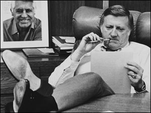 This Oct. 21, 1981, file photo shows New York Yankees owner George Steinbrenner working at his desk at Yankee Stadium in New York, before Game 2 of the World Series. On the wall behind Steinbrenner is an autographed photo of Cary Grant.