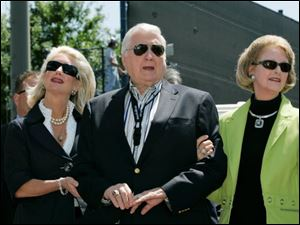 New York Yankees senior vice president for new stadium public affairs Jennifer Steinbrenner Swindal, left, holds onto her father and Yankees principal owner George Steinbrenner, center, along with his wife, Joan, during a pregame ceremony March 27, 2008, renaming Legends Field to George M. Steinbrenner Field at spring training baseball, in Tampa, Fla.