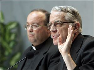 Vatican spokesman Rev. Federico Lombardi, right, and Monsignor Charles Scicluna, the Vatican's sex crimes prosecutor, talk to the media during a briefing to present a new set of norms.