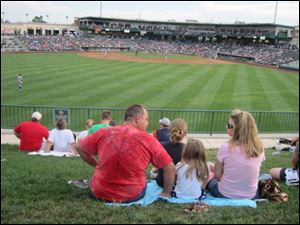 Families can enjoy minor league baseball games from inexpensive lawn seats at the new Parkview Field.