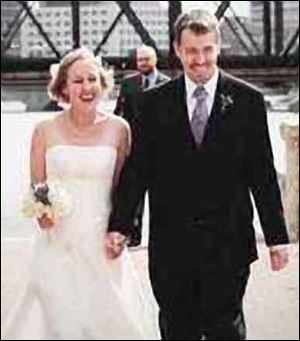 Sarah Lowry, 29, and David McLaughlin, 31, who married in October, are recovering from burns suffered in a freak explosion while they were in Brazil. Both are Ohio State University doctoral students.