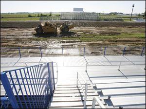 More than a foot of dirt and sod had to be removed from Lake High School's old field to make sure all debris from the June 5 tornado was gone before the synthetic turf could be installed.