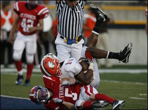 Southview's Allen Gant falls into the end zone over St. Francis' Jake Wawrzyniak for a score. He had six receptions for 139 yards.<br>