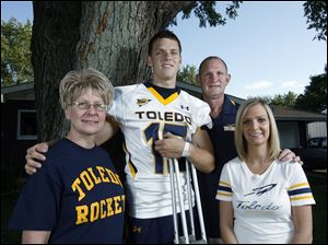 Michael Mathews, who injured his knee in a recent practice, father, Gary, and sister, Emily, are around to offer Michael's mother, Beverly, support in her battle against colon cancer.