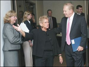 Carol Van Sickle of the Toledo Regional Chamber of Commerce talks with Ted Strickland during a recent campaign stop in the city by the Ohio governor.