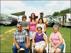 The Rice and Fredrick families of the Fayette area will be camping at the Fulton County Fairgrounds for their 32nd year. Among those in the families are, seated, from left, Richard and Nedra Fredrick and Joan Rice. Behind the the Fredricks are their daughter Kristi and her husband Kip Humbert, and two of their five children Rayce, left and Braelyn.