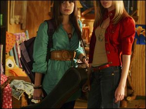 Demi Lovato, left, and Meaghan Jette Martin in a scene from the TV movie 'Camp Rock.' The sequel airs Friday at 8 p.m.