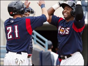 Robinzon Diaz, right, is congratulated by Ben Guez after smacking his first home run of the season on the final day.