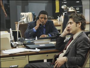 Jon Michael Hill, left, and Michael Imperioli are shown in a scene from the series, 'Detroit 1-8-7.'