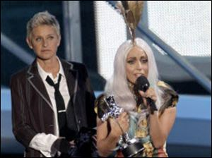 Ellen Degeneres presents Lady Gaga with one of her eight awards Sunday night.