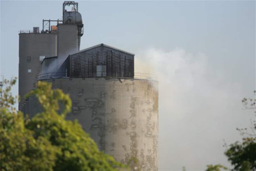 Fire-crews-break-hole-into-grain-elevator-to-douse-fire-threat-of-explosion-ruled-out