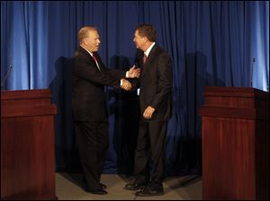 Ohio Gov. Ted Strickland and challenger John Kasich greet one another before the start of the debate at COSI in Columbus.