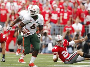 Miami's Lamar Miller returns a kickoff for a touchdown against Ohio State on Saturday.