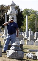 Crews-restore-Clyde-cemetery-hit-by-vandals