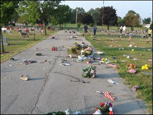 Vandals toppled headstones at McPherson Cemetery and threw flowers and other mementos placed at grave sites onto driveways.