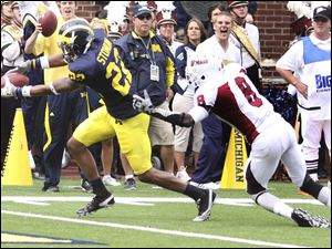 Michigan's Darryl Stonum (22) pulls away from Massachusetts defensive back Mike Lee for a touchdown in the second quarter.