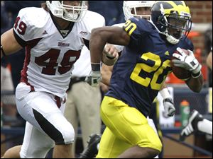 Michigan running back Michael Shaw runs away from the UMass defense in the fourth quarter.