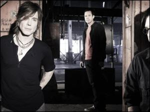Johnny Rzeznik (vocals, guitar), Mike Malinin (drums) and Robby Tackacs (bass, vocals) make up the band The Goo Goo Dolls, who will perform Oct. 6 at Stranahan Theater.